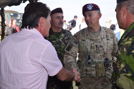 August 26, Galați, Romania. XVIII Airborne Corps Commander Lt. Gen. Stephen J. Townsend shakes hands with Romania's Minister of National Defense Mircea Dusa following an airborne operation at Smardan Training Area, Romania. XVIII Airborne Corps led a Combined Joint Task Force during a joint forcible entry training exercise as part of Operation Swift Response 15. (Photo: dvidshub.net)